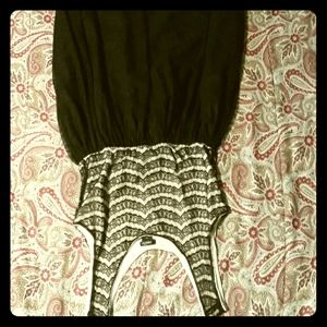 An unused black lace rue 21 dress.